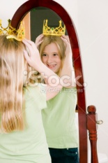 stock-photo-10337028-young-girl-tries-on-crown-looking-in-mirror